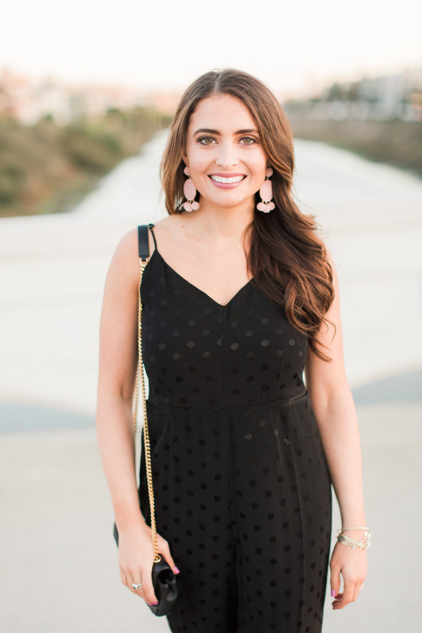 Black polka dot jumpsuit and pink earrings - Baublebar Earrings Sale Favorites by popular Orange County fashion blogger Maxie Elle