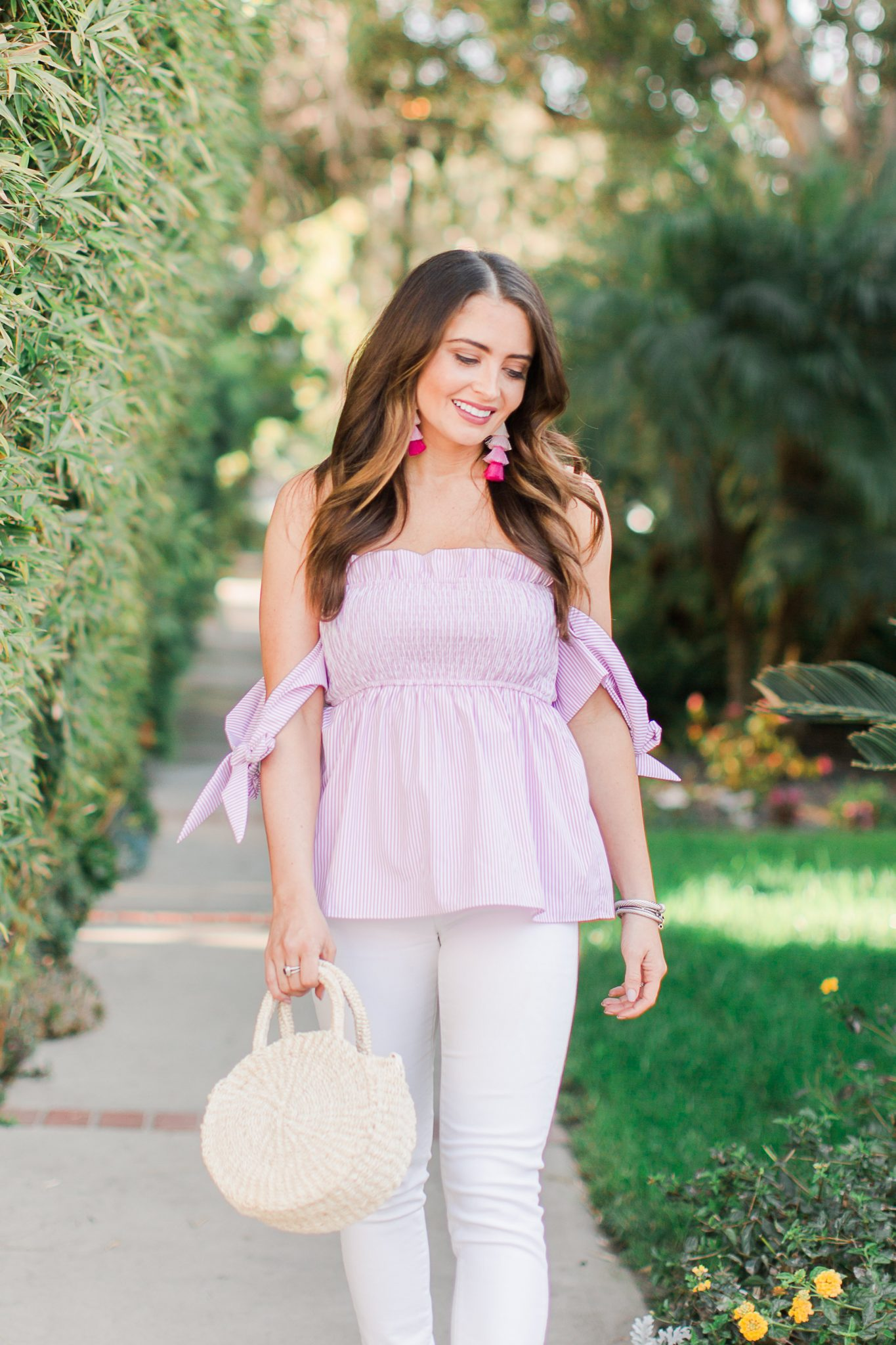 Pink off the shoulder top with white jeans and Clare V bag - Shopbop Sale Spring Picks featured by popular Orange County fashion blogger, Maxie Elle