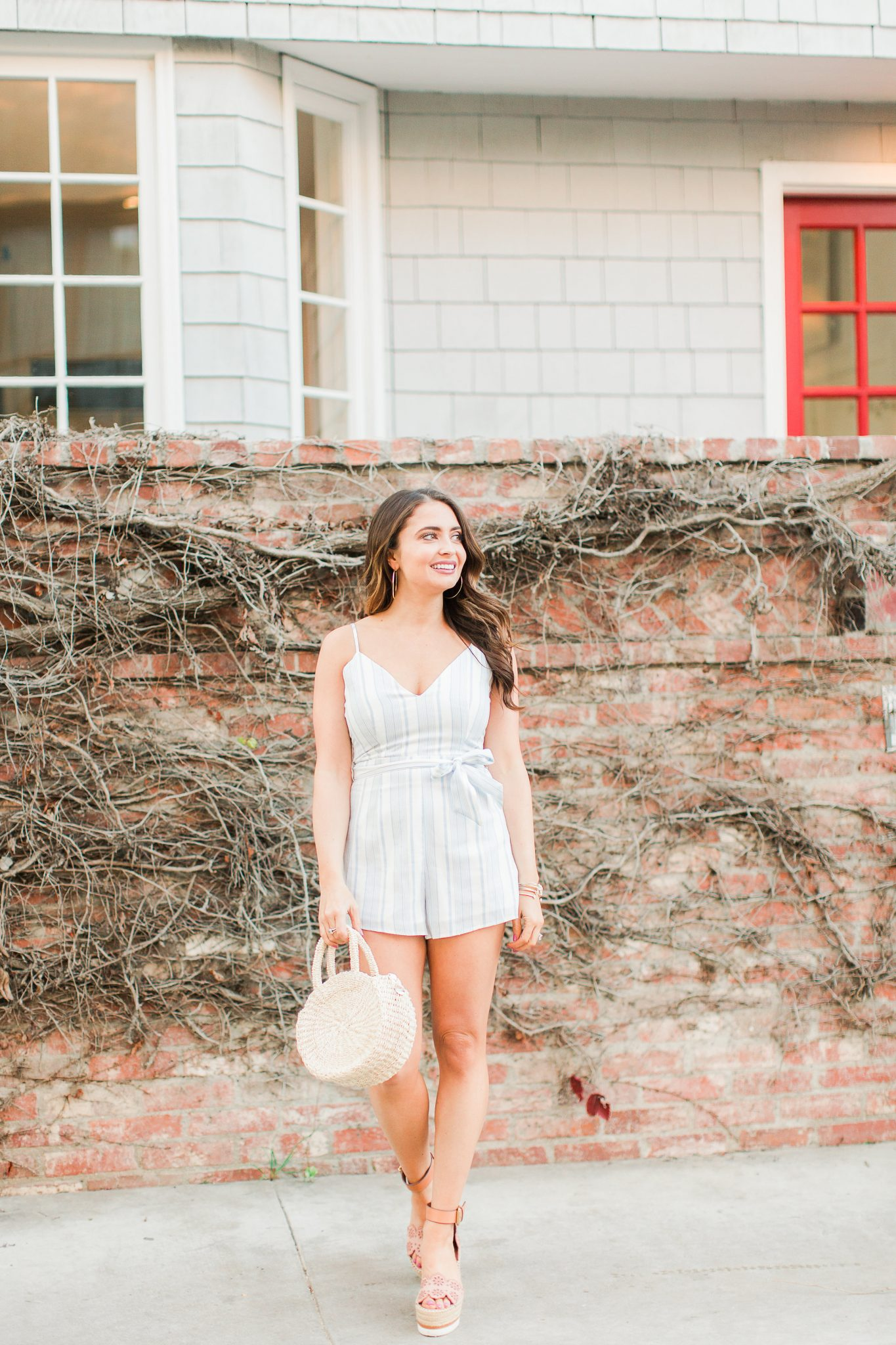 Blue and white REVOLVE striped romper with bow featured by popular Orange County fashion blogger, Maxie Elle